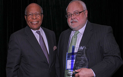 Daniel Avery, MD, (right) professor and chair of the Department of Family Medicine, was the recipient of the Louis W. Sullivan, MD, Health Policy Leadership Award. Sullivan (left) presented the award to Avery on behalf of the American Board of Physician Specialists.